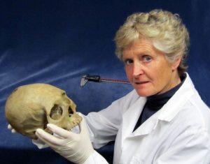 Dr. Diane France holding a skull skull